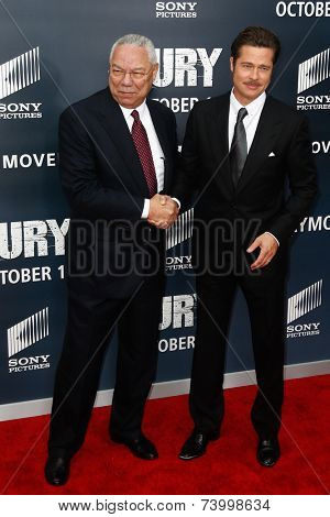 WASHINGTON, DC-OCT 15: General Colin Powell (L) shakes hands with actor Brad Pitt at the world premiere of