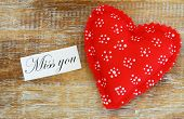 foto of miss you  - Miss you card with red heart on rustic wooden surface - JPG