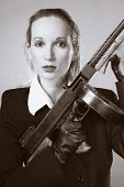 "pic of mafia  - Mafia style fashion studio portrait - nice young woman posing with ""Tommy"" gun for figure and portrait photos in retro criminal style.