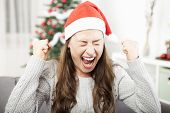foto of sad christmas  - young girl is sad and frustrated about christmas so she screams - JPG