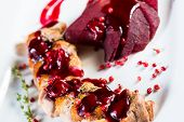 picture of duck breast  - Roasted duck breast with cranberry sauce and vegetables - JPG