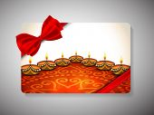 image of diwali lamp  - Diwali festival gift card with illuminated lit lamps on floral decorated floor with ribbon bow - JPG