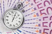 foto of stopwatch  - Time is money concept analog stopwatch on the euro banknotes - JPG