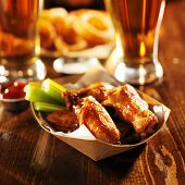 stock photo of celery  - barbecue buffalo chicken wings served with beer - JPG