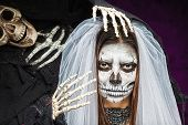 picture of day dead skull  - Young woman a bride in a veil day of the dead mask skull face art and skeleton - JPG