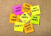 picture of quit  - Group of New year Resolutions Post it Notes on pink yellow orange and green on cork board written with message of diet join gym find love quit smoking and be happy - JPG