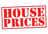 stock photo of deed  - HOUSE PRICES red Rubber Stamp over a white background - JPG