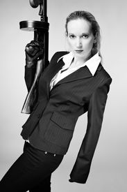 """foto of tommy-gun  - Mafia style fashion studio portrait - nice young woman posing with """"Tommy"""" gun for figure and portrait photos in retro criminal style. ** Note: Soft Focus at 100%, best at smaller sizes - JPG"""