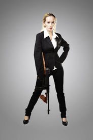 stock photo of tommy-gun  - Mafia style fashion studio portrait  - JPG