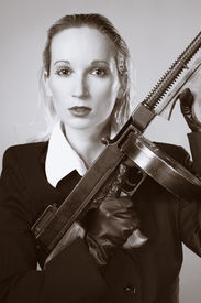 """picture of tommy-gun  - Mafia style fashion studio portrait - nice young woman posing with """"Tommy"""" gun for figure and portrait photos in retro criminal style. ** Note: Soft Focus at 100%, best at smaller sizes - JPG"""