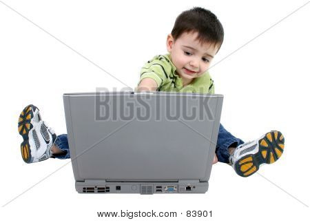 Adorable Boy Working On Laptop Over White