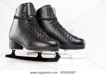 Figure Skating Concept: Professional Mens Figure Skates Isolated Over White Background