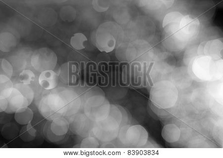 Light festive background. Elegant abstract background with bokeh defocused lights falling down water