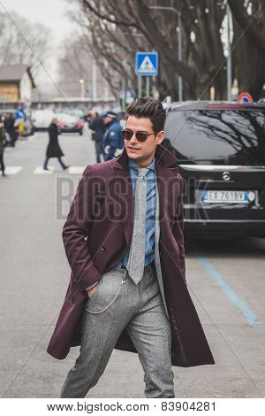 Man Outside Armani Fashion Show Building For Milan Women's Fashion Week 2015