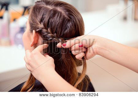 Beautiful woman in hair salon