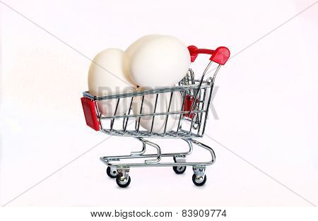 Eggs In The Shopping Cart Isolaten In White