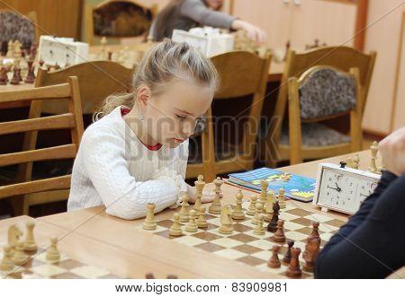 Schoolgirl Playing Chess Tournament