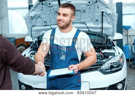 Car mechanic at the service station