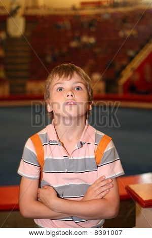 Little Boy In Circus Standing Near Arena And Looking Up Half Body