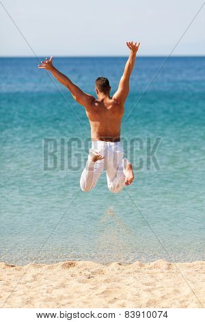 Happy Man Jumping Into Water