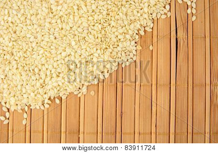 Sesame Seeds Scattered On Wooden Mat In The Corner