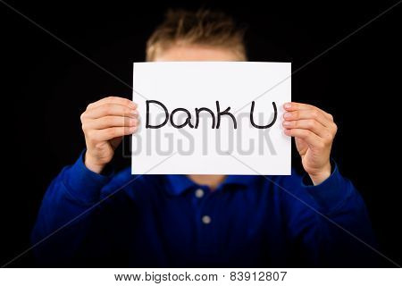 Child Holding Sign With Dutch Words Dank U - Thank You