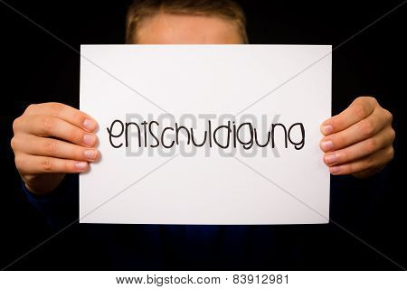 Child Holding Sign With German Word Entschuldigung - Sorry