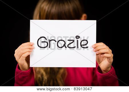 Child Holding Sign With Italian Word Grazie - Thank You