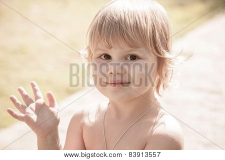 Cute Smiling Caucasian Blond Baby Girl Saying Hello