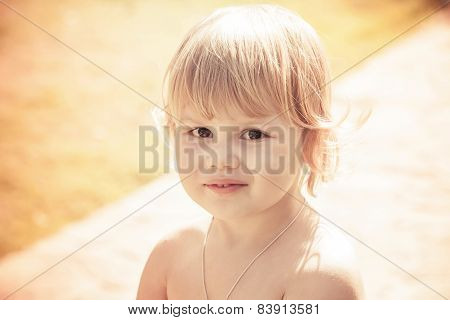 Portrait Of Cute Smiling Caucasian Blond Baby Girl