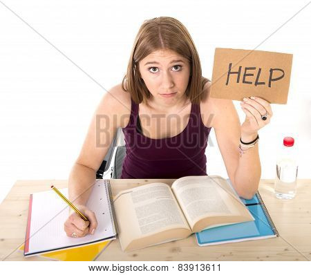 Young Beautiful College Student Girl Studying For University Exam In Stress Asking For Help Under Te
