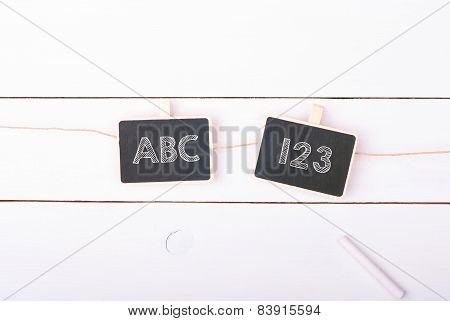 Two school boards chalk on a white wooden background with chalk