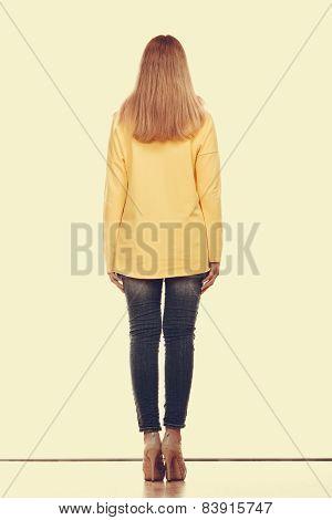 Woman In Denim Pants Yellow Blouse Back View