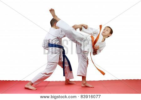 Sportsmen perform paired exercises karate