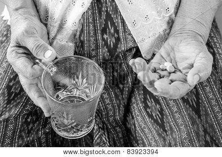 Senior Asian Woman  With Medicine