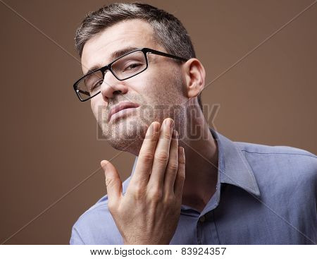 Man Checking His Beard And Skin