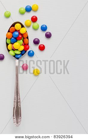 Spoon Full Of Colored Chololate Buttons