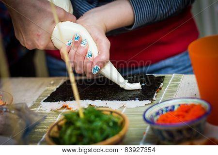 Girl Add Sauce