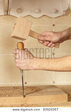 Chisel And Mallet In Hands