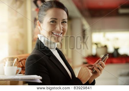 Woman At The Bar Texting With Her Mobile Phone