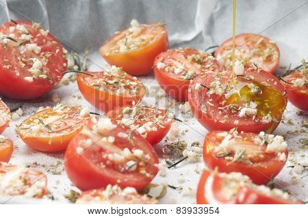 Pouring Olive Oil On Tomatoes