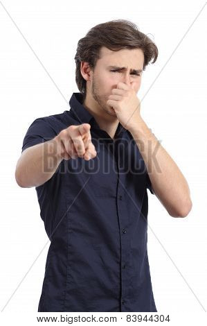Man Pointing At You With Hand Holding Nose Because Bad Stink