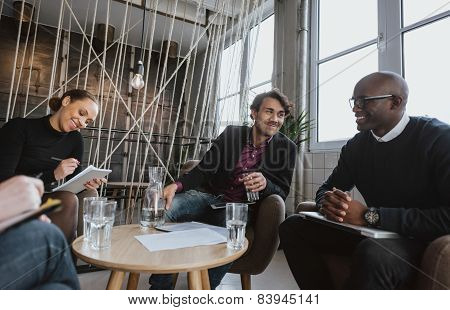 Executives Having A Meeting Indoors