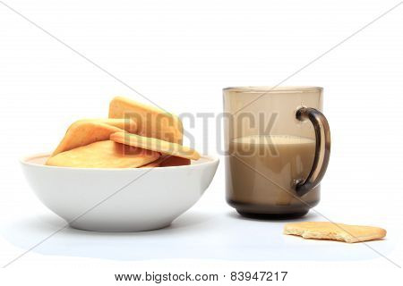 Crackers With A Glass Of Milk On A White Background