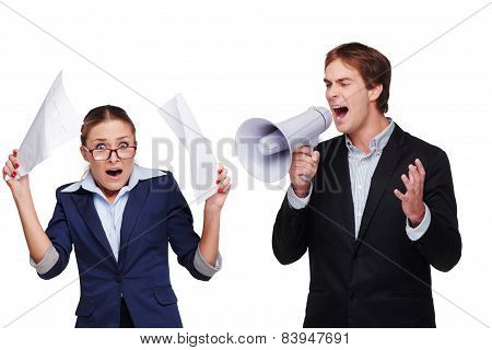 Boss screaming with megaphone at his assistant