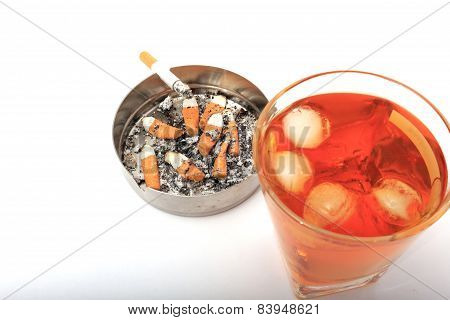 Glass Of Whiskey With Ice. With An Ashtray And A Cigarette On A White Background.