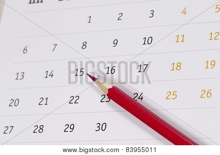 Red Pencil Over Calendar