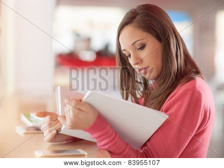 Cute Woman Reading A Book