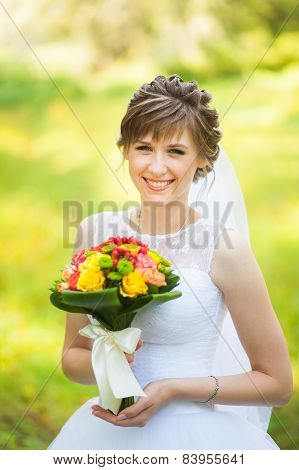 portrait of beautiful wedding bouquet of flowers in hands of young bride