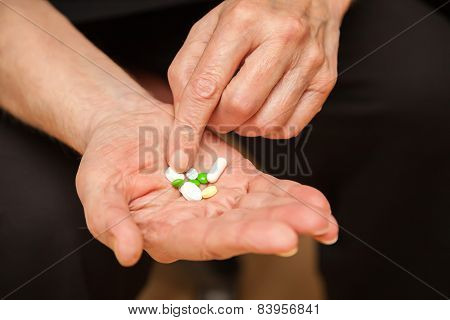 Old Man's Hands With Pills